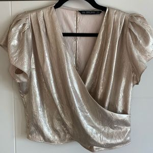 Silk-like gold blouse with buttons up the back